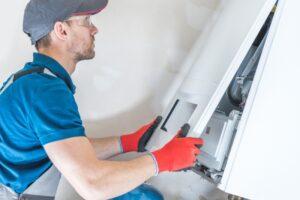 technician-installing-furnace